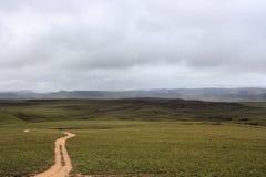 Road to unknown place Gran Sabana Venezuela. Road to unknown place vast fields of Gran Sabana Venezuela stock image