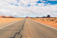 Road to the valley of monuments. In the photo you can see the road to the valley of monuments in the states of Arizona and Utah royalty free stock photo