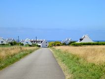 Road to village at the coast of ocean. Brittany Stock Image