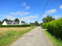 Road to village at the coast of ocean. Brittany Royalty Free Stock Photography