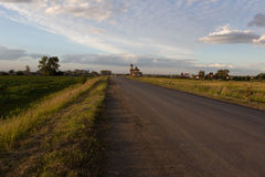 The road to the village. In the Russian village, at the entrance of the ruined Church Royalty Free Stock Photography