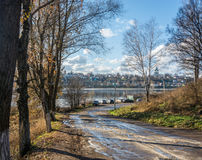 The road to the Volga river in the town of Tutaev. The road going down to the Volga river in the town of Tutaev, Yaroslavl region. Sunny autumn day royalty free stock image