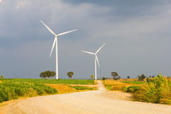 Road to wind turbine Stock Image