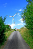 Road to wind turbines Stock Photo