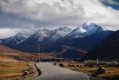 Road to Yading Nature Reserve. In autumn. Yading is located in Daocheng County, Sichuan Province, China.  it is a mountain sanctuary and major Tibetan Royalty Free Stock Photos