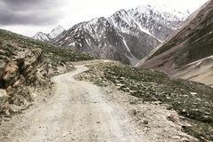 Road to Zanskar. Curly road to the snow peaks royalty free stock photo
