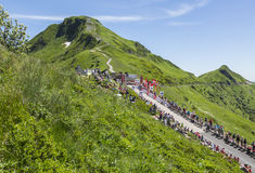The Road - Tour de France 2016. Pas de Peyrol, France - July 6,2016: Crowds of fans waiting for the peloton on the side of the road to Pas de Pyerol Puy Mary in Stock Images