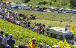 Road of Tour de France - Tour de France 2016. Col du Grand Colombier,France - July 17, 2016: The cyclists Majka and Zakarin riding through a crowd of spectators Royalty Free Stock Photo