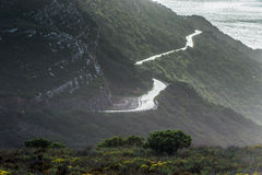 Road toward fog and the ocean. Table Mountain. South Africa Stock Photo