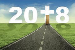 Road toward number 2018 with a cross symbol Stock Photo