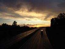 The road toward the setting sun. Royalty Free Stock Images