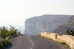 Road Towards Cliffs, Malta. A descending road leading to a distant cliff in Gozo, Malta Stock Photos