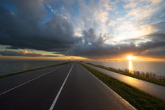 Road towards the sunset Royalty Free Stock Images
