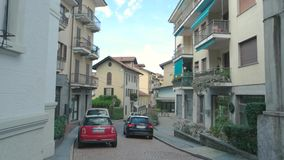 Road and town buildings. Cars parked in the street. Spend Summer in Italy stock video footage