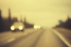 Road track and Cars headlights Background Blurred Royalty Free Stock Photos