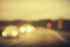 Road track and Cars headlights Background Blurred Royalty Free Stock Image