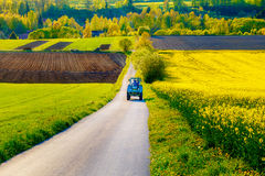 Road with tractor in a beautiful region with flower meadows and fields. Slovakia, Central Europe, Liptov. Stock Photography