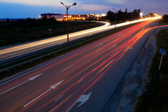 Road traffic. Light trails of evening highway Royalty Free Stock Photos