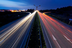 Road traffic. Light trails of evening highway Stock Images