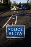Road traffic accident 1. Road traffic accident with Police Slow sign, England Stock Images