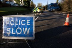 Road traffic accident 2. Road traffic accident with Police Slow sign, England Royalty Free Stock Photography