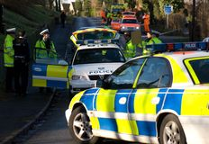Road traffic accident 3. Road traffic accident with Police Slow sign, England Stock Photos