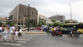 Road traffic in Athens. GREECE, ATHENS, JUNE 7, 2013: Road traffic near Parliament and Syntagma square in Athens, Greece, June 7, 2013 stock footage