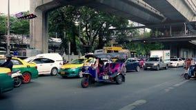 Road Traffic In Bangkok In Daytime. Cars and tuk-tuks passing on road in central area. Bangkok. Bangkok, Thailand, August 2015 stock video footage