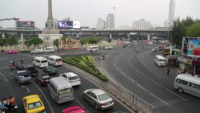 Road traffic in Bangkok, Thailand. THAILAND, BANGKOK, APRIL 11, 2014: Road traffic near Victory Monument in Bangkok, Thailand stock video footage