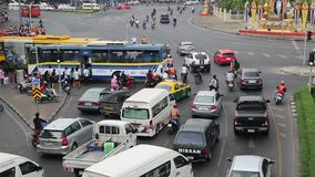 Road traffic in Bangkok, Thailand. THAILAND, BANGKOK, APRIL 11, 2014: Road traffic near Victory Monument in Bangkok, Thailand stock video