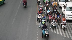 Road traffic in Bangkok, Thailand. Many people ride motorcycles. THAILAND, BANGKOK, APRIL 11, 2014: Road traffic in Bangkok, Thailand. Many people ride stock footage