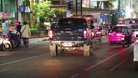 Road traffic on the Beach Road in Pattaya, Thailand. THAILAND, PATTAYA, MARCH 31, 2014: Road traffic on the Beach Road in Pattaya, Thailand stock footage