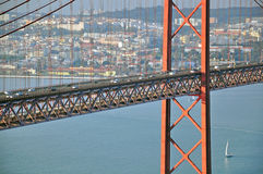 Road traffic on the bridge. Of 25th April in Lisbon, Portugal Stock Photos