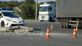 Road traffic cone and police on accident site Stock Photography