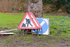 Road traffic control signs stacked against tree Royalty Free Stock Photography