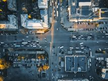 Road traffic on crossroad or intersection downtown of European city, aerial or top view. Toned royalty free stock photography