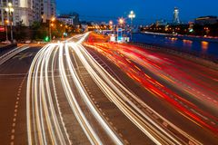 Road traffic in the evening on embankment Royalty Free Stock Photo