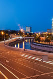 Road traffic in the evening on embankment Royalty Free Stock Image