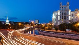 Road traffic in the evening on embankment Royalty Free Stock Photos