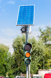 Road traffic light and solar panel Royalty Free Stock Photography