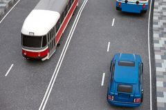 Road traffic miniature with toy models of a modern tram, car and trolley bus.  stock photography