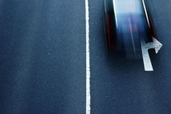 Road traffic. The motion strip of passing cars at an intersection Royalty Free Stock Images