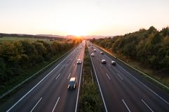 The road traffic on a motorway at sunset.  stock images