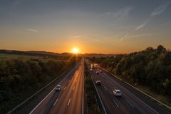 The road traffic on a motorway at sunset.  royalty free stock images