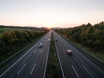 The road traffic on a motorway at sunset.  stock photography