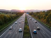 The road traffic on a motorway at sunset.  royalty free stock image