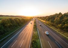 The road traffic on a motorway at sunset.  stock photos
