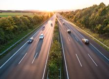 The road traffic on a motorway at sunset.  royalty free stock photography