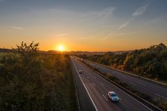 The road traffic on a motorway at sunset.  royalty free stock photo