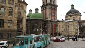 Road traffic near the Dormition or Assumption church in Lviv, Western Ukraine stock video footage